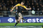The blue-legged Beauden Barrett in action for the Hurricanes. Photo / Getty