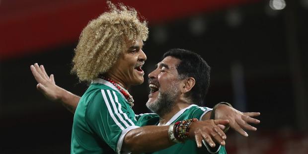 FIFA Legend Carlos Valderrama celebrates Diego Maradona. Photo / Getty