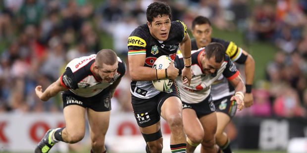 Dallin Watene-Zelezniak of the Panthers makes a break through the Warriors defence. Photo / Getty