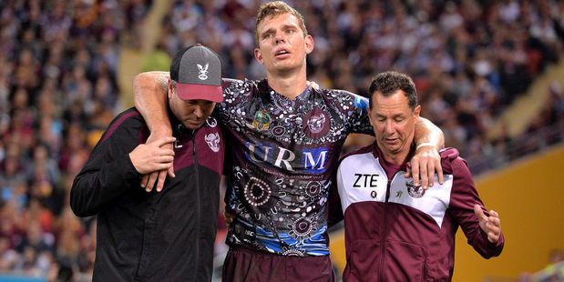 Tom Trbojevic of the Sea Eagles is taken from the field injured. Photo / Getty