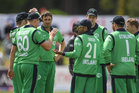 Simi Singh of Ireland is congratulated by his team-mates after catching George Worker. Photo / Getty