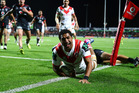 Kalifa Faifai Loa of the Dragons celebrates scoring a try against the Warriors. Photo / Getty