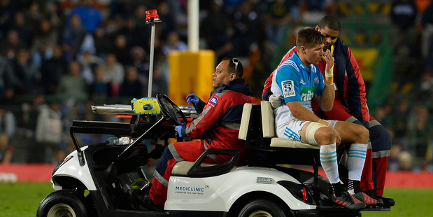 Piers Francis leaves the match against the Stormers on a medical cart after being knocked unconscious. Photo / Getty Images.