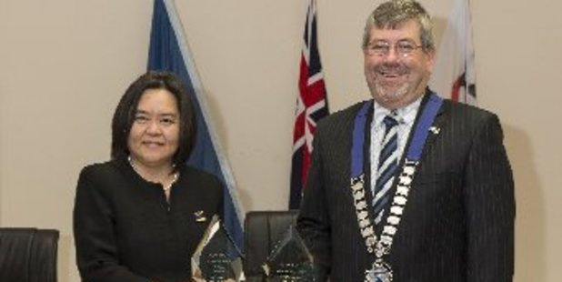 Gigi Crawford of Zealong Tea Estate and mayor Allan Sanson of Waikato District Council, with the three trophies won by Zealong Tea Estate at the 2017 Global Tea Championship Fall in Colorado, US.