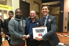 Mayor Justin Lester receives the petition supporting the living wage for city council workers. Photo / Frances Cook