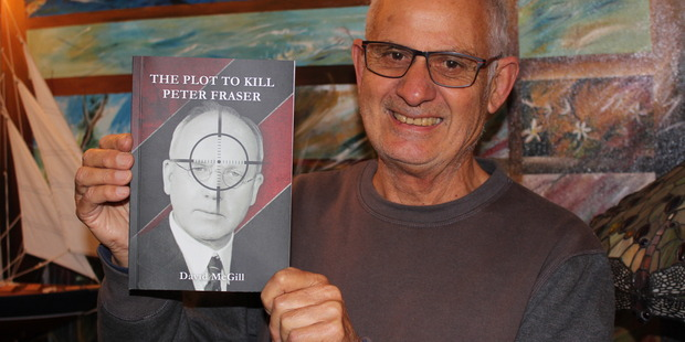 THRILLER: David McGill holds a copy of his latest book The Plot To Kill Peter Fraser.