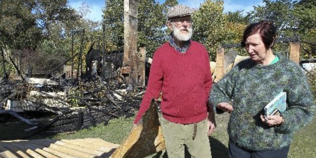 Ongaonga residents Martin and Leigh Gillard inspect the ruins of their house, destroyed by fire. Photo / Warren Buckland