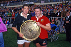 Gavin Hastings and Sean Fitzpatrick with the trophy after the third test between the All Blacks and British Lions at Eden Park. Photo/Photosport