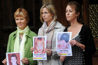 Sarah Godwin (left) with Kate McCann, mother of Madeleine, and Nicki Durbin, whose son Luke is also missing. Photo / AFP