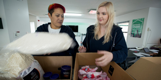 Rosie Stanton (right), with Student Council president Matalena O'Mara (left), helps distribute food for hungry students every Monday. Photo / Dean Purcell