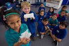 Eve Pene (left) and Christian Webb-Foote, and their class at Malfroy School take part in the Kleenex SneezeSafe Healthy Classrooms programme. Photo/Ben Fraser