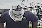 One of the four masked offenders who robbed the Kingsford Supermarket in Mangere last night. Photo / NZ Police
