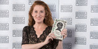 Author Catherine Chidgey with her award-winning book The Wish Child.