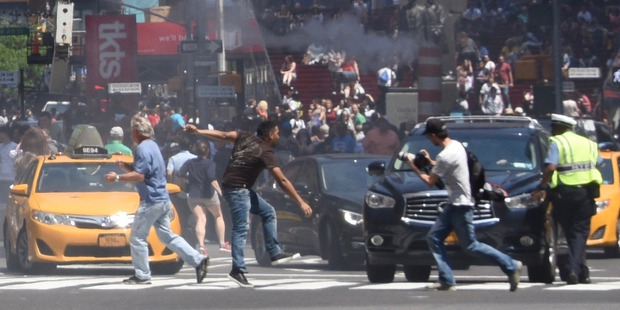 Loading The photos captured by Kiwi photographer Helen Klisser During show a man fleeing immediately after the crash in Times Square. Photo / Helen Klisser During, supplied to the NZ Herald