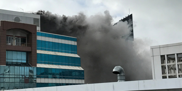 Loading The massive fire at the corner of Mayoral Drive and Queen St in central Auckland sent plumes of black smoke billowing into the Auckland skyline yesterday. Photo / Supplied