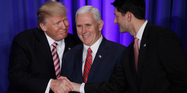 Pence, centre, with Paul Ryan, right, is the most prominent and highest-ranked of President Trump's lackeys. Photo / AP