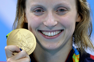 FILE - In this Aug. 12, 2016, file photo, United States' Katie Ledecky shows off her gold medal in the women's 800-meter freestyle. Photo / AP.