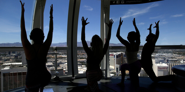 People take part in a yoga class at the High Roller observation wheel in Las Vegas. Photo / AP
