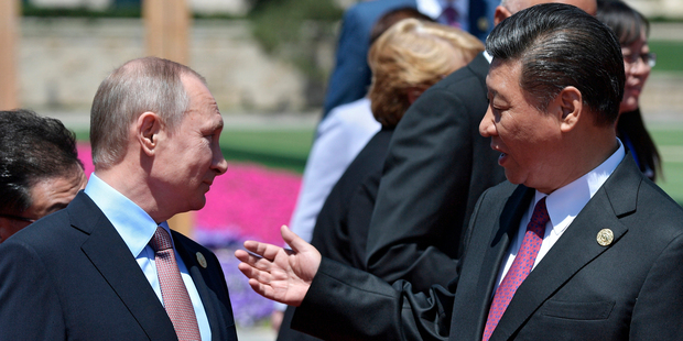 Chinese President Xi Jinping, right, and Russian President Vladimir Putin talk to each other after the photo op. Photo / AP