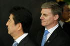 New Zealand Prime Minister Bill English, right, meets with Japan's Prime Minister Shinzo Abe at Abe's official residence in Tokyo. Photo / AP