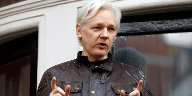 Loading Julian Assange speaks to the media outside the Ecuadorian embassy in London. Picture / AP