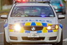 A man fleeing police in Hamilton has been critically injured after crashing into a parked patrol car. Photo / NZME