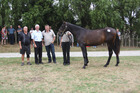 Ken Breckon, left to horse, stopped in at Karaka last season to pay $44,000 for a brother to his next day Jewels winner Partyon. Photo / File