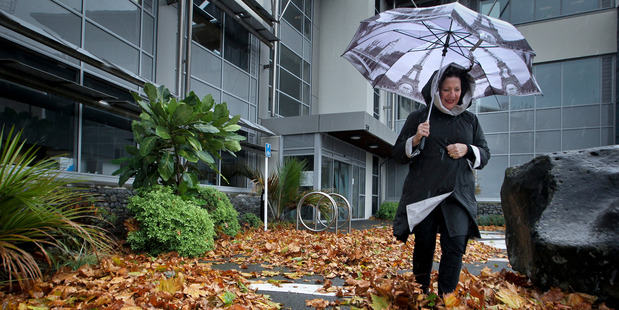 CHILLY BLAST: Hawke's Bay Regional Council receptionist Lyn Bowker braved the wet and windy weather yesterday in Napier. Photo/Warren Buckland.