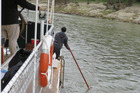JOURNEY STALLS: The crew of the Wairua try to find a channel to get upriver at the Ramahiku rapid.