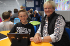 Harry Fox shows his stand-in nan's stand-in, Nana Jos, how to do computer coding during Riverview School's grandparents day. Photo / Peter de Graaf