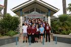 Sir John Kirwan and his hosts at Kaitaia College. Photo / Kirsty Saxon
