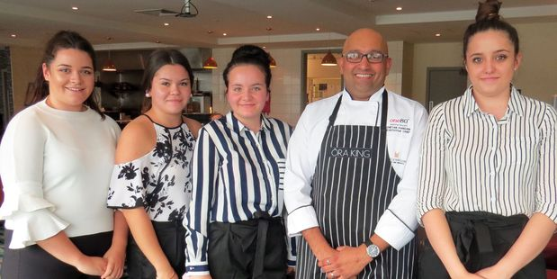 Fine dining was experienced by Waiopehu College students, from left, Tiana Thomas, Chantelle Cundy, Maya Machuca, Copthorne Hotel executive chef Cheten Pangam, and Amber Graham. WGP 17May17 - FIN