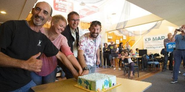 Cutting a cake to celebrate the 25th birthday of the Kapiti Marine Reserve, from left, Karl Webber, Angela Buswell, Colin Giddy and Ben Knight. Photo / Neil Price