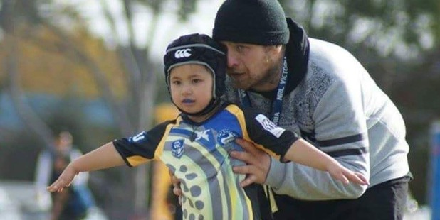 Boss Pomare, supporting his daughter Jekaylah-Rae, 5, at a rugby league game before he almost died after being struck and dragged by a ute. Photo / Supplied