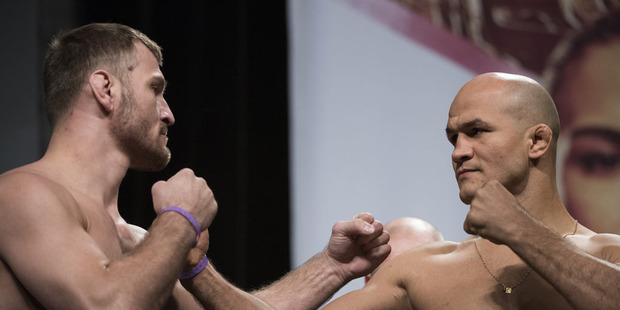 Stipe Miocic faces off with Junior dos Santos during the UFC 211 weigh-in. Photo / Getty Images.