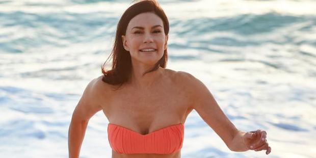 Her methods are clearly working as the 70-year-old looks fantastic in an orange bikini. Photo / Supplied
