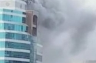 Smoke pours from a building on Auckland's Queen Street
