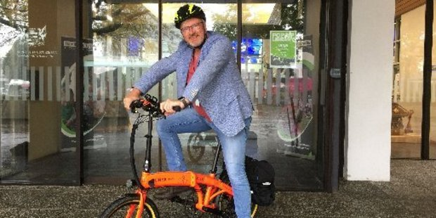 Councillor Mark Bunting sets off on his e-bike.