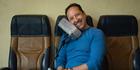 Ephi Zlotnitsky, an Israeli-born entrepreneur, tries out his new airplane pillow. Photo / Sarah L. Voisin
