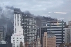 Smoke pours from a building in downtown Auckland. Video/Sara Cairney