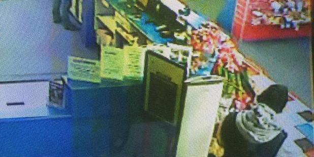 The offenders brandished a rifle at the store attendant. Photo / Police