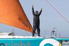 Conrad Colman celebrates crossing the finish line of the Vendee Globe race. Photo / Conrad Colman