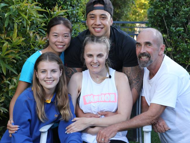 Crystal Brown (centre) at home with her family. From left to right: Daughter Paige Ritchie, stepmum Limei Hu, partner Joseph Papa and dad Steve Brown. Photo/News Corp Australia
