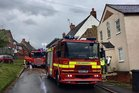 Fire engines at the scene of a house blaze in Warwickshire which began after a pet snake wrapped itself around a heater. Photo/Warwickshire FRS/Twitter