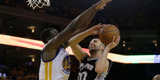 San Antonio Spurs guard Manu Ginobili (20) shoots against Golden State Warriors forward Draymond Green. Photo / AP