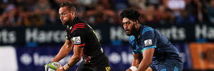 Chiefs' first five Aaron Cruden against Akira Ioane of the Blues. Photo / Photosport