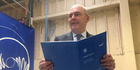 Finance Minister Steven Joyce at Petone printing plant with Budget speech. Photo / Gia Garrick
