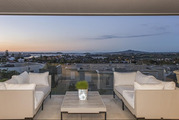 The apartment boasts floor-to-ceiling windows with views across the Waitemata Harbour to Rangitoto. Photo / Bayleys