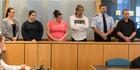 Michelle Blom, Nicola Jones, Julie-Ann Torrance, Cameron Hakeke, (court security), Wayne Blackett in the Auckland High Court. Photo / Brett Phibbs