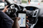 Uber's new pricing system could see people who live in certain suburbs pay more. Photo / File